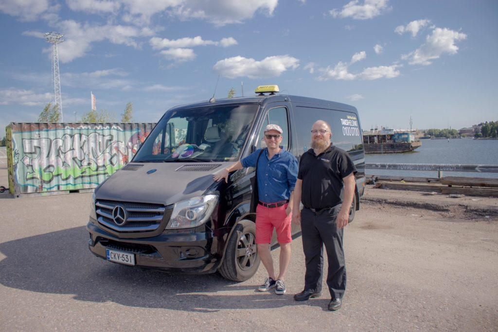 Hannu Medina of We Speak Gay Community and taxi driver Janne Ström of Taksi Helsinki